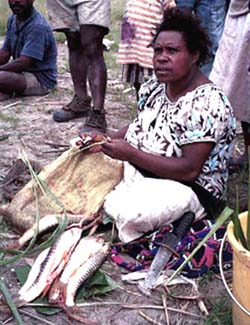 A woman in Papua Guinea selling fish
