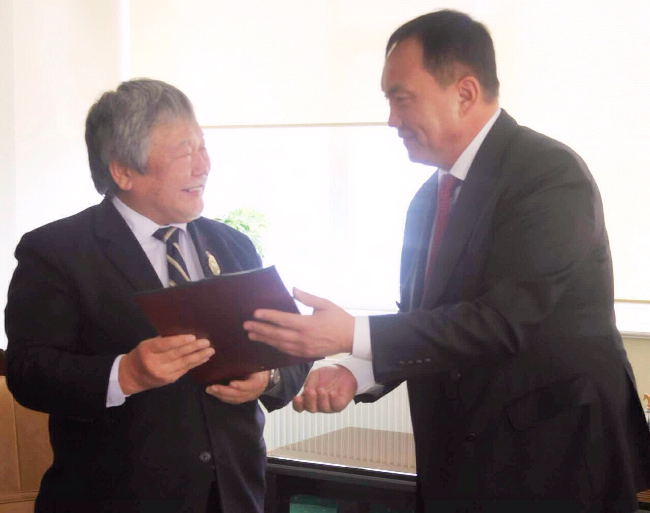 "FAO Assistant Director-General and Regional Representative for Asia and the Pacific, Hiroyuki Konuma, meets with TUVDENDORJ Sharavdorj, Minister for Industry and Agriculture, Mongolia, in the capital Ulaanbaatar. During the meeting Mr Konuma was presented with a medallion as '1st rank honor agriculture award"" for his contribution to  the food and agriculture sector of Mongolia'.  Mongolia successfully hosted the FAO Thirty Second Regional Conference for Asia and the Pacific in Ulaanbaatar in March 2014"