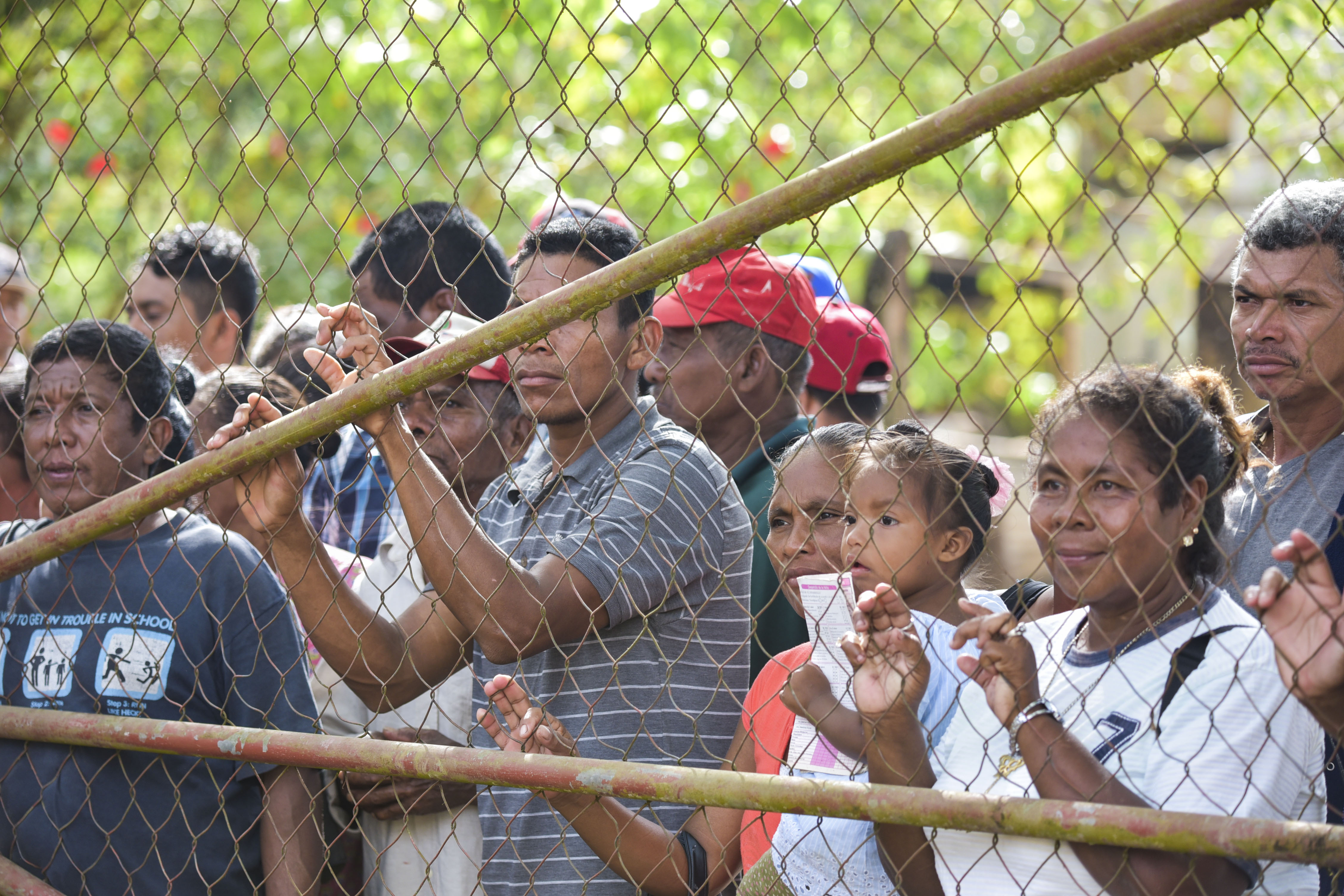 Citizens of Nicaragua line up outside a local clinic
