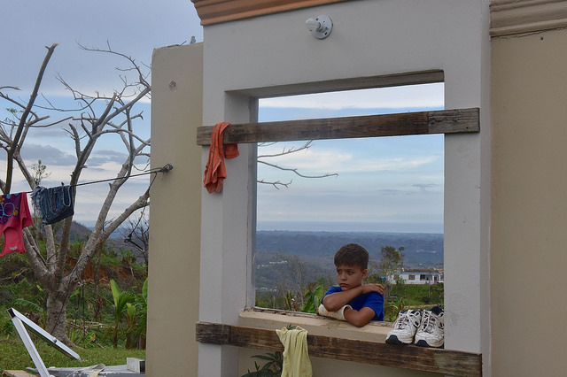 A child stands in what is left of his house in Utuado, Puerto Rico, which was almost completely destroyed by Hurricane Maria Oct. 12, 2017.