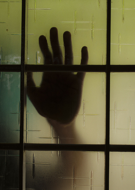 hand against the glass