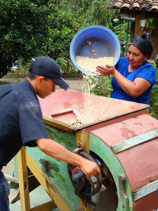 Family grinding corn to prepare tortillas in Ocotal, Nicaragua.