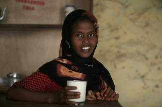 Girl with a glass of milk in Afar, Ethiopia