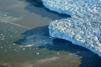 View of Arctic Circle, showing the impact of climate change on icebergs and glaciers.