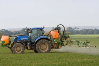 Spraying crops with herbicide