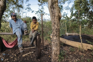 Producer shows compost based on treated coffee pulp that he will use to make a coffee plant and forestry trees nursery in his land at La Dalia municipality, Nicaragua.