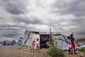Dark clouds loom over a camp for people displaced by the January 2010 earthquake, in Port-au-Prince, Haiti.