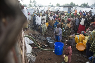 People waiting at the water tank, Democratic Republic of Congo