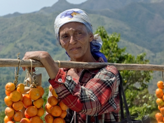 A woman sells oranges in the mountains near Baracoa, Cuba.