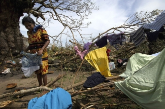 A Nicaraguan woman in an area hit by a hurricane in 2007.