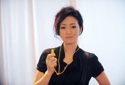 Gong Li in ad. photos