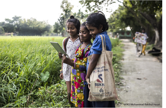 Panjarbhanga, Bangladesh - Children use a computer tablet as a learning device ©FAOMohammad Rakibul Hasan